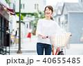若い女性(買い物・自転車) 40655485