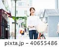 若い女性(買い物・自転車) 40655486