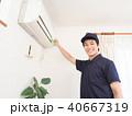 エアコン 掃除 男性の写真 40667319