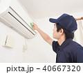 エアコン 掃除 男性の写真 40667320