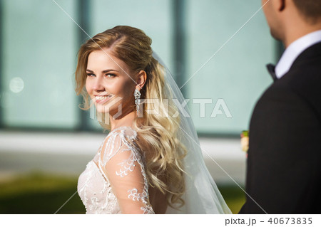 lovely bride and groom near the modern building 40673835