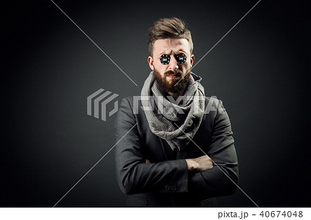 Man with two pocker chips in eyes 40674048