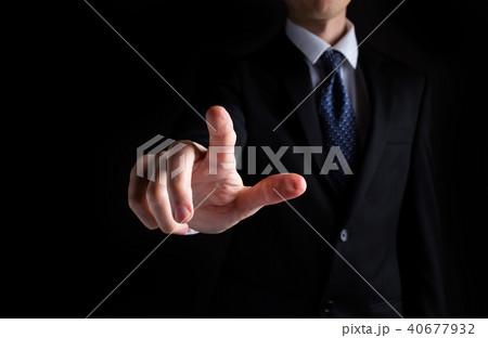 Man pointing or pressing something 40677932