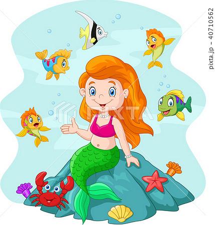 Happy little mermaid sitting on the rock surrounde 40710562