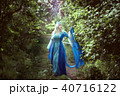 Young woman elf standing in a fairy forest. 40716122
