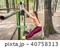 Couple doing full fitness workout in outdoor gym 40758313