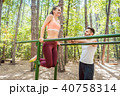 Fit woman exercising on parallel bar with her boyfriend 40758314