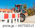 Construction worker starting road works on site 40758315