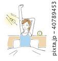 ベッドの上で背伸びをする女性 朝 40789453