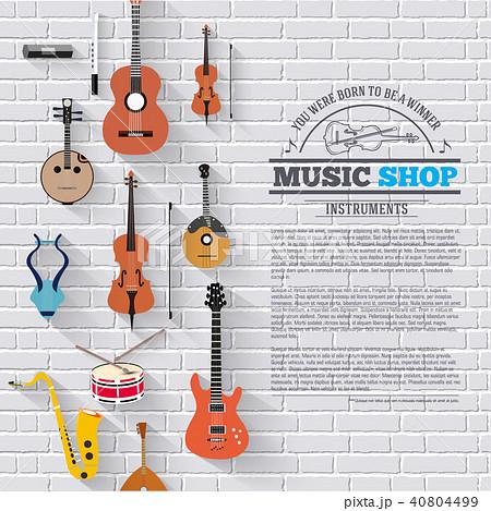 Music instruments on white modern brick wall  40804499