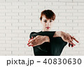 pretty woman in black dress, with red castanets 40830630