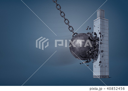 3d rendering of giant iron wrecking ball breaks in pieces when it hits a business skyscraper. 40852456