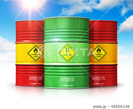 Green biofuel drum in front of red oil gas barrels 40856146
