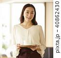 女性 カフェ 店員の写真 40862430