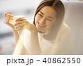 女性 カフェ ティータイムの写真 40862550