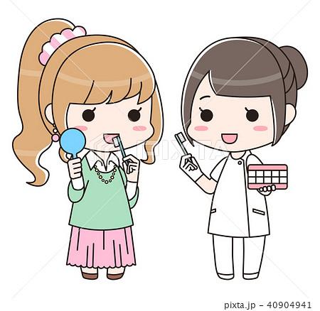 女性に歯磨き指導をする歯科衛生士の女性(全身) 40904941