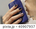 Beautiful female hand with manicure  40907937