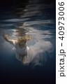 Woman in white dress under water 40973006