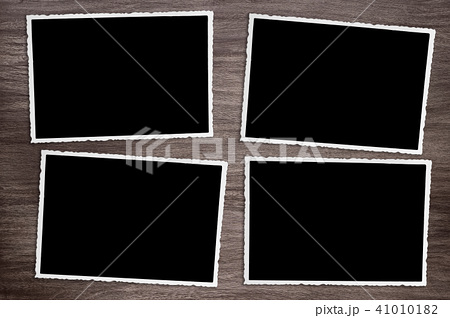 four old vintage photos on wooden background 41010182
