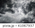 Dramatic thunderstorm clouds background at dark sk 41067937