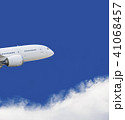 Commercial airplane flying over blue sky and white 41068457