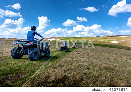 Friends driving off-road with quad bike or ATV and UTV vehicles 41071636