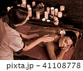 Massage of woman in spa salon. Luxary interior oriental therapy. 41108778
