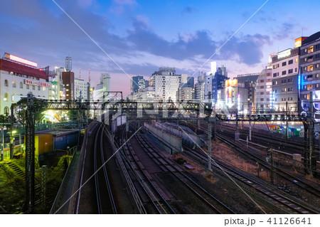池袋 線路と街並み 夜景の写真素材