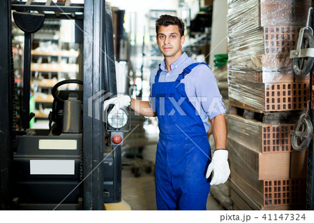 Man in uniform on his workplace 41147324