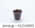 Coffee beans in a glass cup isolated 41210803