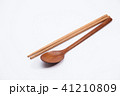 Wooden spoon and chopsticks on white background 41210809