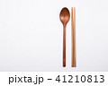 Wooden spoon and chopsticks on white background 41210813