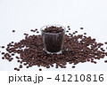 Coffee beans with a glass 41210816