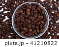 Coffee beans with a glass 41210822