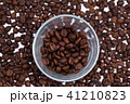 Coffee beans with a glass 41210823