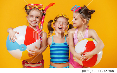 funny funny happy children in bathing suits jumping on coloredの写真