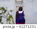 Teenage girl going up from wooden ladder 41271231