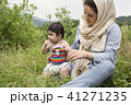 Wide view of Muslim mother and little baby enjoy 41271235