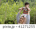 Young Muslim mother holding a little baby overhead 41271255