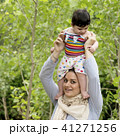 Young Muslim mother holding a little baby overhed 41271256