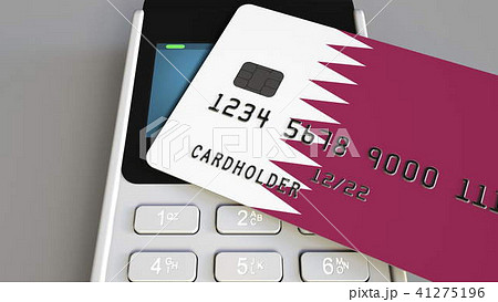 Payment or POS terminal with credit card featuring flag of Qatar. Qatari retail commerce or banking 41275196