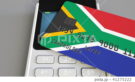 Payment or POS terminal with credit card featuring flag of South Africa. SAR retail commerce or 41275222