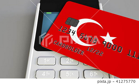Payment or POS terminal with credit card featuring flag of Turkey. Turkish retail commerce or 41275770