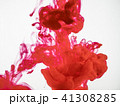 Close up on droplet of red ink in water. Movement 41308285