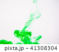 Green acrylic paint swirling under water. Image of 41308304