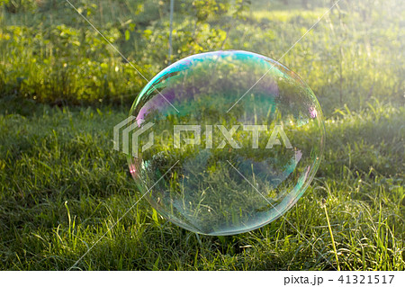 Big soap bubble flying in the air 41321517