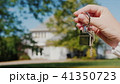 The hand holds the key to the house. Rent and purchase of housing concept 41350723