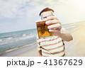 listening to music and drinking beer on the beach 41367629