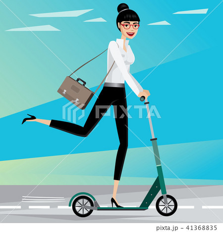 Business woman rides a scooter 41368835