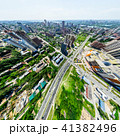 Aerial city view with crossroads and roads, houses, buildings, parks and parking lots. Sunny summer 41382496